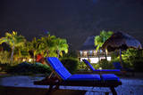 A Starry Night View of a Deck Chair and a Villa at Villas Flamingos Hotel on Holbox Island, Mexico Photographic Print by Karine Aigner