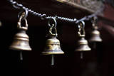 Brass Bells Hang at the Entryway to a Temple in Kathmandu, Nepal Photographic Print by Sergio Ballivian