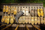 Rubber Boots Dry Out at a Lodge in Tambopata Reserve in Peru's Amazon Basin Photographic Print by Sergio Ballivian