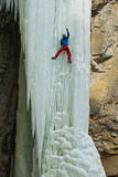 A Male Ice Climber Climbing the 6th Pitch of Broken Hearts, (Wi5), Cody Wyoming Photographic Print by Daniel Gambino