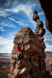 A Male Climber on the Third Pitch of Classic Tower Climb Ancient Art, Fisher Towers, Moab, Utah Photographic Print by Dan Holz