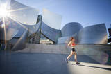 A Young Woman Runs at the Walt Disney Concert Hall in Downtown Los Angeles, California Photographic Print by Carlo Acenas