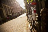 Bicycle in an Alley Street in Amsterdam, Netherlands Photographic Print by Carlo Acenas