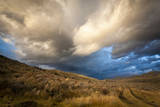 Storm Clouds Gather over a Hilly Area of Antelope Flats in Grand Teton National Park, Wyoming Photographic Print by Mike Cavaroc