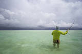 Male Angler and Guide Wade the Flats with Approaching Storm Photographic Print by Matt Jones