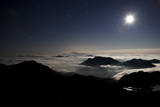 Moon Sand Stars Shine Above Low Lying Clouds on Mount Rainier National Park Photographic Print by Dan Holz