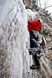 Male Climber Leads Up a Vertical Frozen Waterfall in a Snow Storm, Vail, Colorado Photographic Print by Daniel Gambino