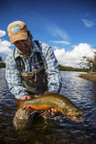 A Male Fly Fishing Guide Holds a Beautiful Male Brook Trout Photographic Print by Matt Jones