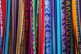 Cloths, Blankets, Scarves, and Hammocks Hang on Display at the Otavalo Market, in Otavalo, Ecuador Photographic Print by Karine Aigner