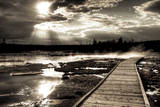 Yellowstone, Wyoming: a Wooden Path Going Through Norris Geyser Basin on a Cloudy Sunset Photographic Print by Brad Beck
