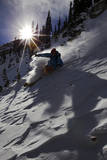 A Male Skier Travels Down the Mountain at Snowbird, Utah Photographic Print by Adam Barker