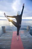 Young Woman Doing Yoga on Pier in Tahoe City, California Photographic Print by Justin Bailie