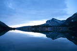 Glacier, Montana: Many Glacier Lodge Reflects Off of Swifcurrent Lake During Sunrise Photographic Print by Brad Beck