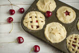 A Tin Filled with Small Fresh Cherry Pies Ready to Go into the Oven Photographic Print by Cynthia Classen