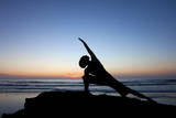 A Young Woman Performs Yoga at Blacks Beach in San Diego, California Photographic Print by Brett Holman
