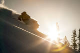 A Young Skier Chases the Sun Down the Ski Slope in the Wasatch Backcountry, Utah Photographic Print by Louis Arevalo