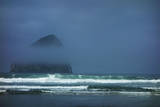 Morning Mist Partially Covers Haystack Rock in Cape Kiwanda, Oregon Photographic Print by Arnab Banerjee
