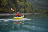 Young Woman Kayaking on Chilko Lake in British Columbia, Canada Photographic Print by Justin Bailie