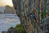 A Young Male Climber Ascends the Coastal Route: Kuda Laut a 5.11A in Siung Beach Photographic Print by Dan Holz