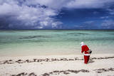 Santa Clause Patrols the Beaches of Alphonse Island for Feeding Fish Photographic Print by Matt Jones