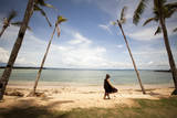 A Woman Walks with Her Shoes Off on the Beach Near the Exclusive Balesin Island Club, Philippines Photographic Print by Carlo Acenas