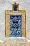 Tunisia, Sidi Bou Said. Blue Door in Stone Frame Photographic Print by Charles Cecil