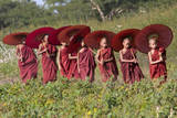 Myanmar, Bagan. Young Novice Monks with Umbrellas Photographic Print by Charles Cecil