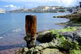 Bollard Squats on the Marsamxett Harbor of Malta Shore with Valletta Photographic Print by Richard Wright