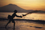 Indonesia, Bali, Silhouette of Fisherman Fishing at Sanur Beach Photographic Print by Dave Bartruff