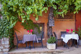 Outdoor Cafe in Roussillon, Provence, France Photographic Print by Brian Jannsen
