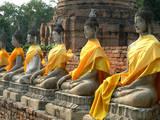 Thailand, Ayutthaya, Wat Yai Chaiyamongkhan. Row of Buddha Statues Photographic Print by Kevin Oke
