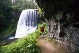 Hiker Looking at Waterfall Photographic Print by Craig Tuttle