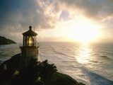 Lighthouse Overlooking Sunset Photographic Print by Craig Tuttle