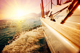 Yacht Sailing against Sunset. Sailboat. Yachting. Sailing. Travel Concept. Vacation Posters by Subbotina Anna