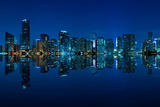 Miami Skyline at Night - Panoramic Image with Beautiful Water Reflections Photographic Print by  badboo