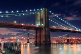 Brooklyn Bridge Closeup over East River at Night in New York City Manhattan with Lights and Reflect Photo by Songquan Deng