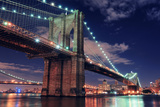 Brooklyn Bridge Closeup over East River at Night in New York City Manhattan with Lights and Reflect Posters by Songquan Deng