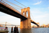 Brooklyn Bridge over East River Viewed from New York City Lower Manhattan Waterfront at Sunset. Prints by Songquan Deng