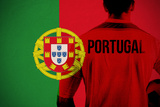Portugal Football Player Holding Ball against Portugal National Flag Photographic Print by Wavebreak Media Ltd