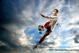 A Soccer Player Photographic Print by  olly2