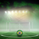 Football in Brasil Colours against Football Pitch under Spotlights Photographic Print by Wavebreak Media Ltd