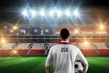 Usa Football Player Holding Ball against Stadium Full of Usa Football Fans Photographic Print by Wavebreak Media Ltd