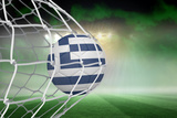 Football in Greece Colours at Back of Net against Football Pitch under Green Sky and Spotlights Photographic Print by Wavebreak Media Ltd