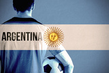 Argentina Football Player Holding Ball against Argentina National Flag Photographic Print by Wavebreak Media Ltd