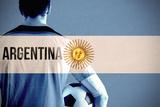 Argentina Football Player Holding Ball against Argentina National Flag Photographic Print by Wavebreak Media Ltd