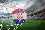 Football in Croatia Colours at Back of Net against Large Football Stadium with Lights Photographic Print by Wavebreak Media Ltd