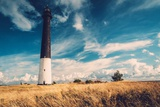 Lighthouse against  Beautiful Cloudscape Poster by NejroN Photo