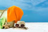 Summer Beach Bag with Coral,Towel and Flip Flops on Sandy Beach Photographic Print by  oleggawriloff