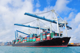 Cargo Ship at Miami Harbor with Crane and Blue Sky over Sea. Photographic Print by Songquan Deng