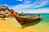 Thai Longtail Boat Anchored in a Turqouise Bay Posters by  vitalytitov